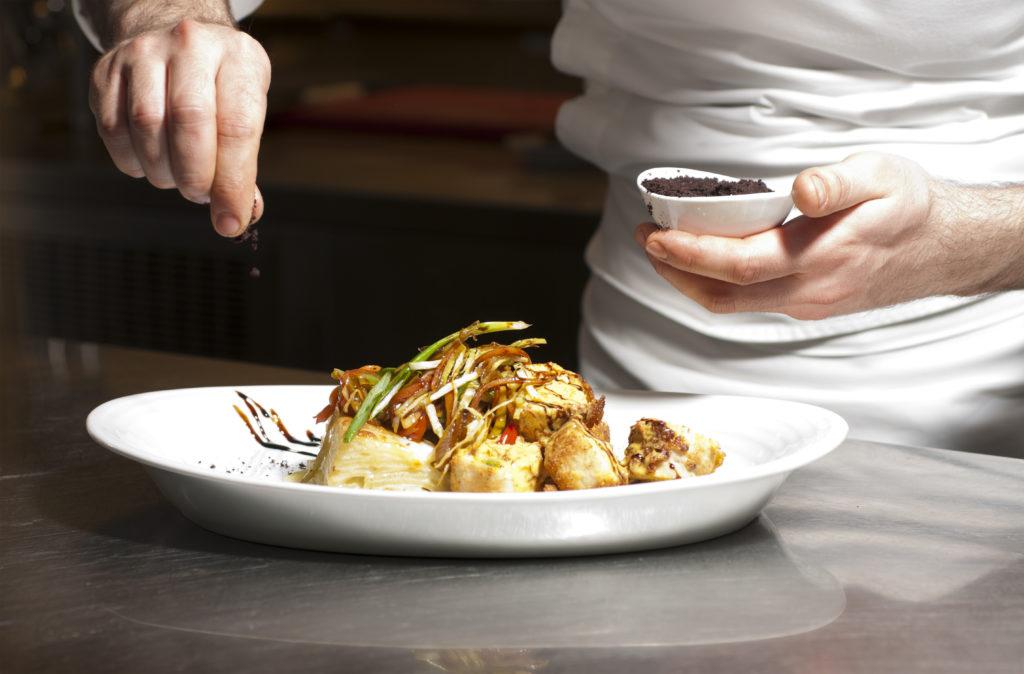 Chef preparing foods.