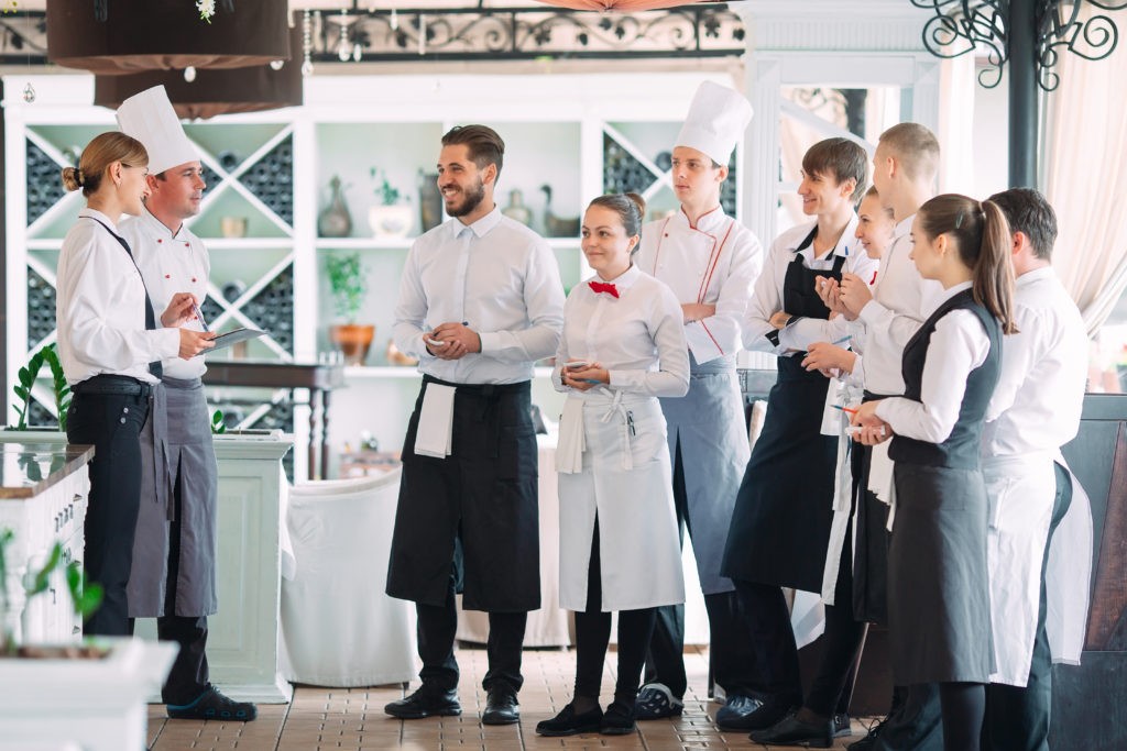 Restaurant staff speaking with the head chef