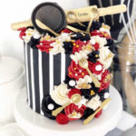 Escoffier logo cake-black and white striped with small kitchen utensils