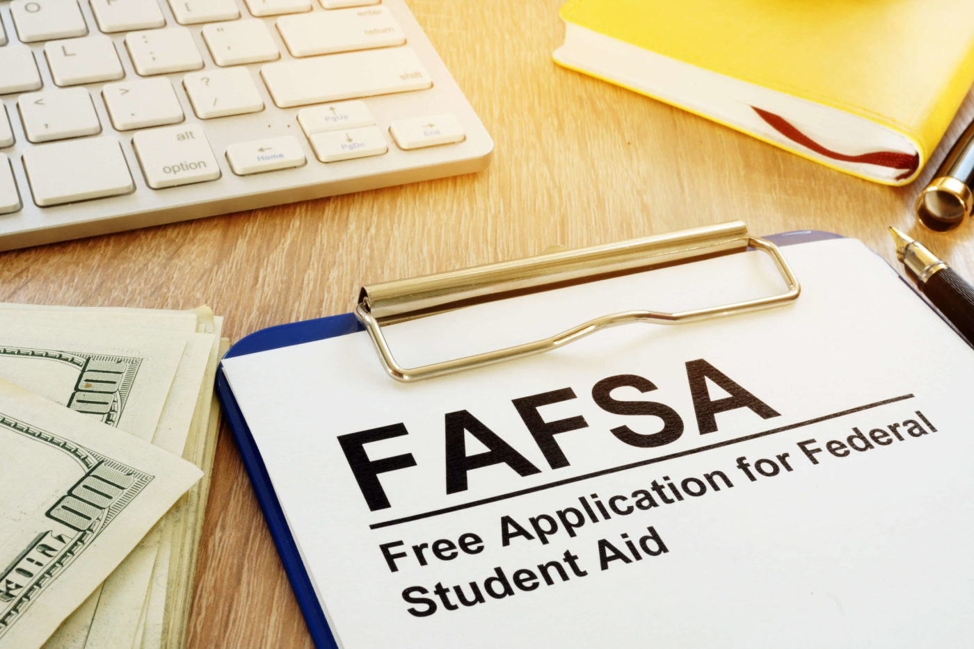 Free Application for Federal Student Aid (FAFSA) on a clipboard