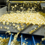 Close-Up Of Potato Chips In Machine